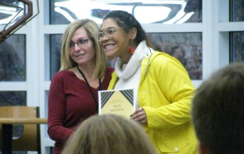 Makayla Anderson receives an award in recognition of her kindness and character.